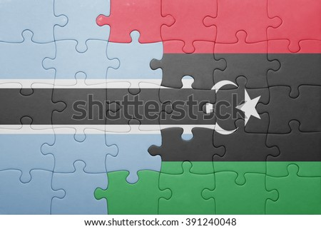 puzzle with the national flag of botswana and libya . concept