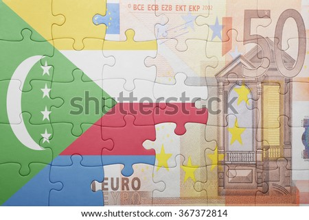 puzzle with the national flag of comoros and euro banknote . concept - stock photo
