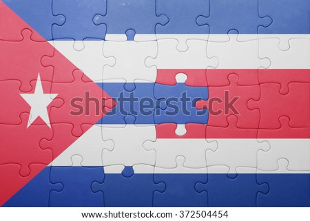 puzzle with the national flag of costa rica and cuba . concept - stock photo