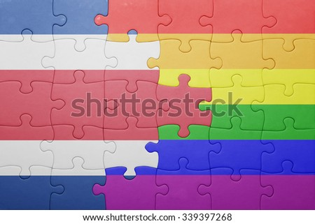 puzzle with the national flag of costa rica and gay flag.concept - stock photo