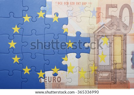 puzzle with the national flag of european union and euro banknote . concept - stock photo