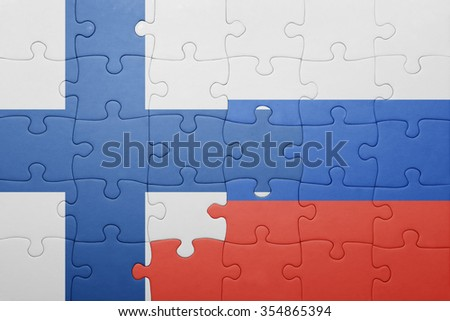 puzzle with the national flag of finland and russia . concept