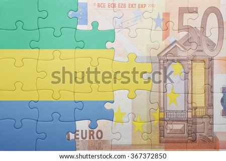 puzzle with the national flag of gabon and euro banknote . concept - stock photo