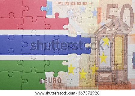 puzzle with the national flag of gambia and euro banknote . concept - stock photo