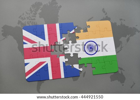 puzzle with the national flag of great britain and india on a world map background. - stock photo