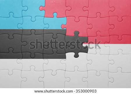 puzzle with the national flag of indonesia and estonia . concept