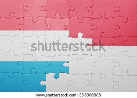 puzzle with the national flag of indonesia and luxembourg . concept
