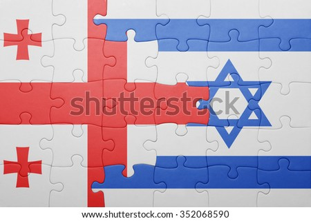 puzzle with the national flag of israel and georgia . concept