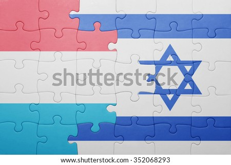 puzzle with the national flag of israel and luxembourg . concept