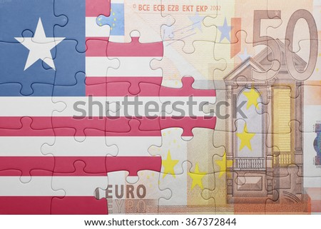 puzzle with the national flag of liberia and euro banknote . concept - stock photo