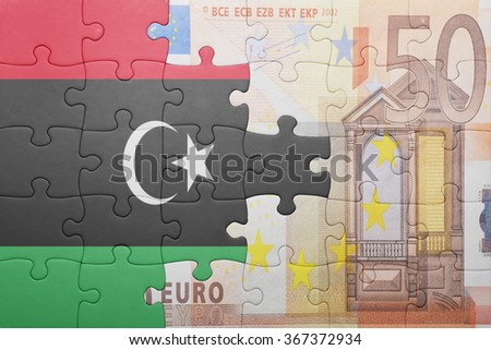 puzzle with the national flag of libya and euro banknote . concept - stock photo