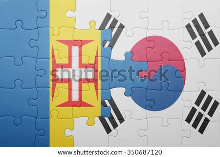 puzzle with the national flag of madeira and south korea . concept