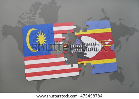 puzzle with the national flag of malaysia and swaziland on a world map background. 3D illustration