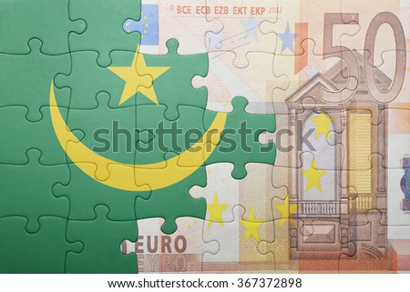 puzzle with the national flag of mauritania and euro banknote . concept - stock photo