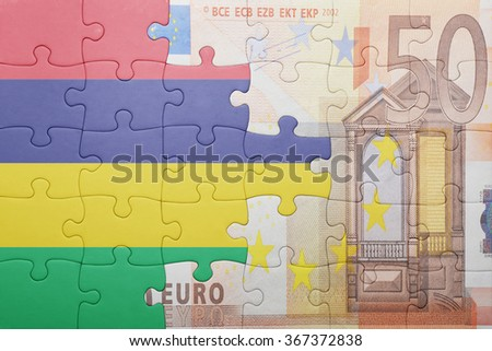 puzzle with the national flag of mauritius and euro banknote . concept - stock photo