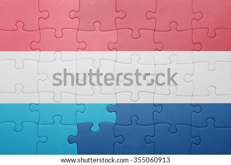 puzzle with the national flag of netherlands and luxembourg . concept