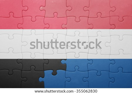 puzzle with the national flag of netherlands and yemen . concept