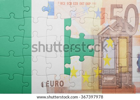 puzzle with the national flag of nigeria and euro banknote . concept - stock photo