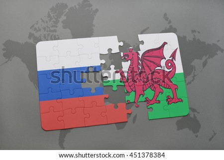 puzzle with the national flag of russia and wales on a world map background. 3D illustration - stock photo