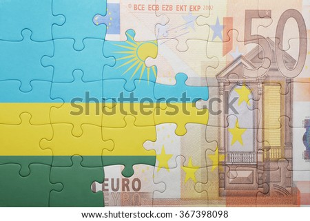 puzzle with the national flag of rwanda and euro banknote . concept - stock photo
