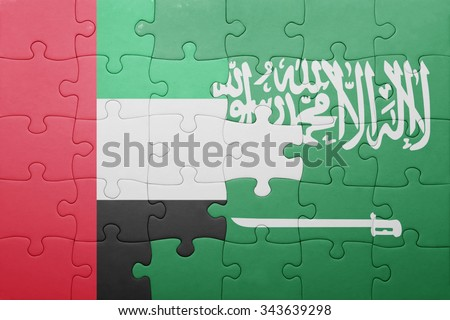 puzzle with the national flag of saudi arabia and united arab emirates . concept - stock photo