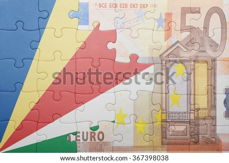 puzzle with the national flag of seychelles and euro banknote . concept - stock photo