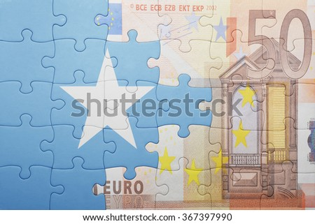 puzzle with the national flag of somalia and euro banknote . concept - stock photo