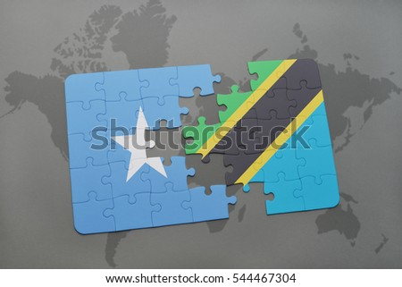 puzzle with the national flag of somalia and tanzania on a world map background. 3D illustration