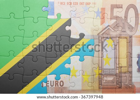 puzzle with the national flag of tanzania and euro banknote . concept - stock photo