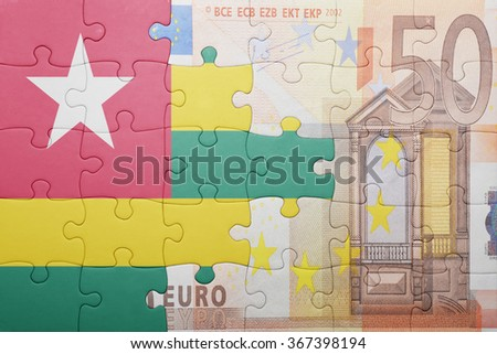 puzzle with the national flag of togo and euro banknote . concept - stock photo