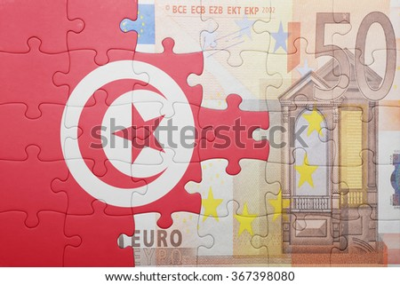 puzzle with the national flag of tunisia and euro banknote . concept - stock photo