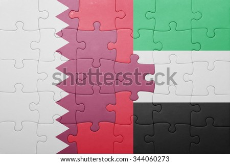 puzzle with the national flag of united arab emirates and qatar . concept