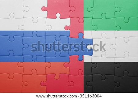 puzzle with the national flag of united arab emirates and russia . concept - stock photo