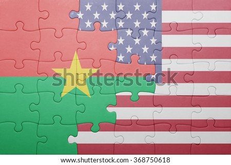 puzzle with the national flag of united states of america and  burkina faso.concept - stock photo
