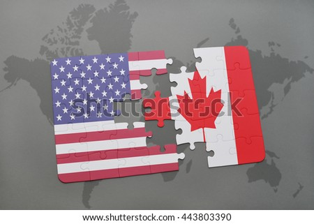 puzzle with the national flag of united states of america and canada on a world map background - stock photo