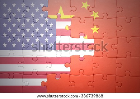 puzzle with the national flag of united states of america and china .concept - stock photo