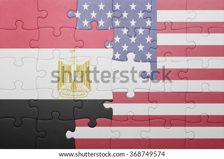 puzzle with the national flag of united states of america and egypt .concept