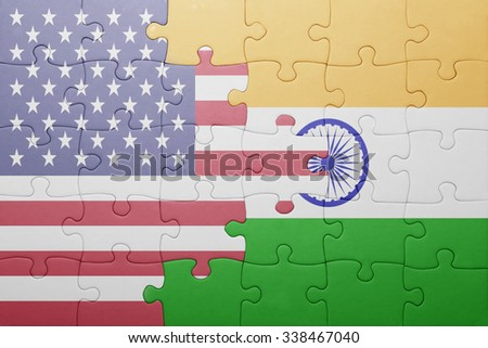 puzzle with the national flag of united states of america and india.concept - stock photo