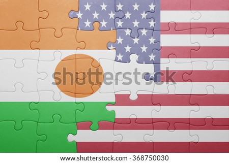 puzzle with the national flag of united states of america and niger .concept - stock photo