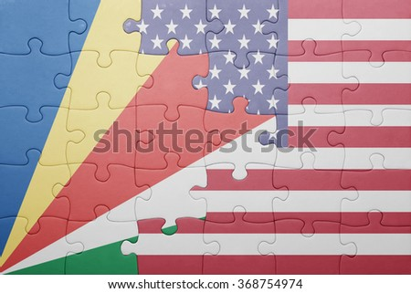 puzzle with the national flag of united states of america and seychelles .concept