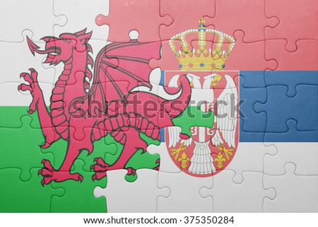 puzzle with the national flag of wales and serbia . concept