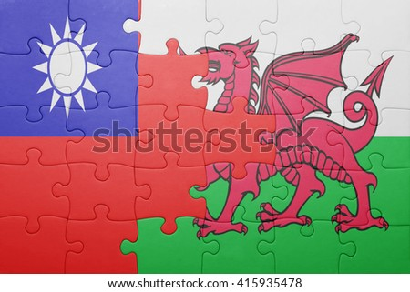 puzzle with the national flag of wales and taiwan . concept - stock photo