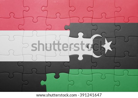 puzzle with the national flag of yemen and libya . concept