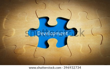 puzzle with word development - stock photo