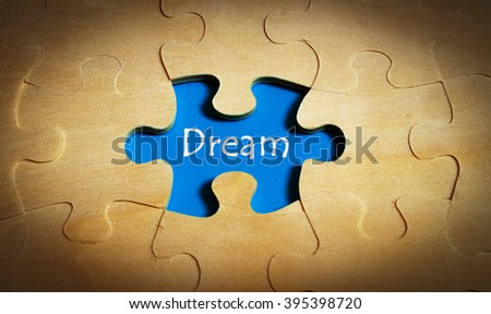 Puzzle with word dream - stock photo