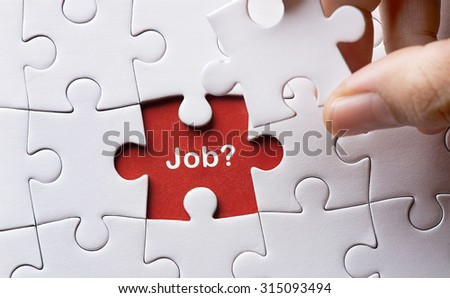 Puzzle with word job - stock photo
