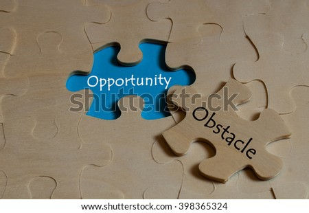 puzzle with word opportunity and obstacle - stock photo