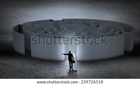 Puzzled businessman standing near entrance of labyrinth - stock photo