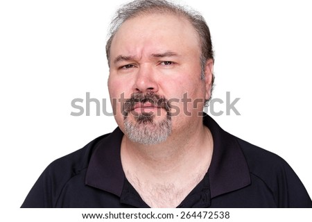 Puzzled middle-aged man with a goatee frowning and looking at the camera with a look of distrust isolated on white - stock photo