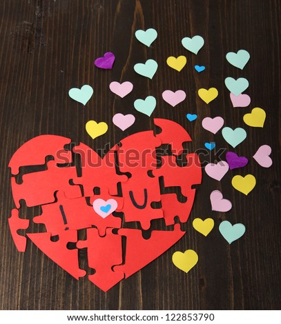Puzzles in form of heart - stock photo